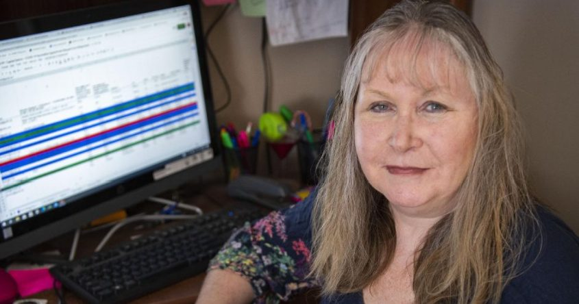 Anne Berger, who helps schedule COVID-19 vaccine appointments for other people, sits in front of her computer in her Niskayuna home on Saturday.