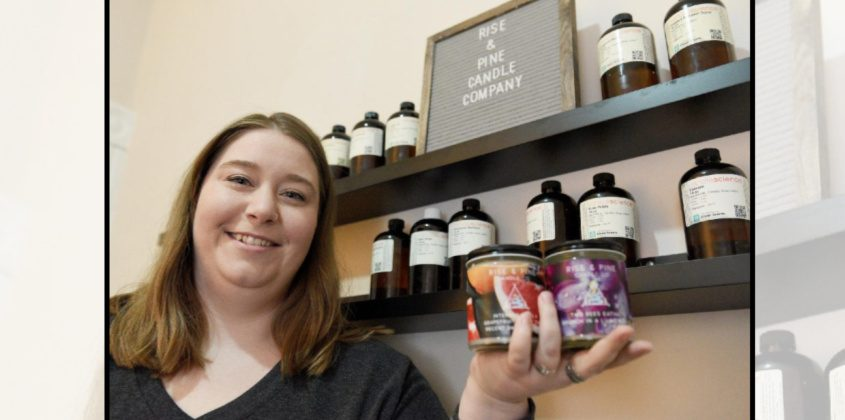 Christine Ekstrom poses with a couple of her Rise & Pine branded candles, which she makes in her Schenectady home, on Friday.