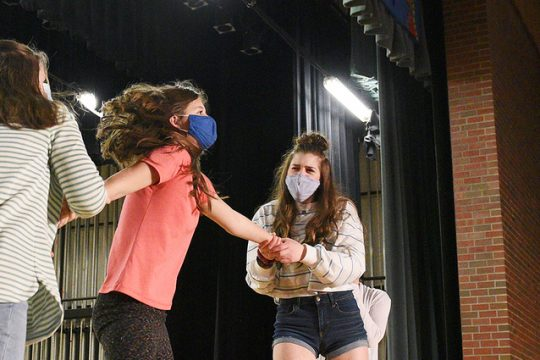 Students on stage during rehearsal for their performance of 'Annie' to-be released May 7th and 8th online