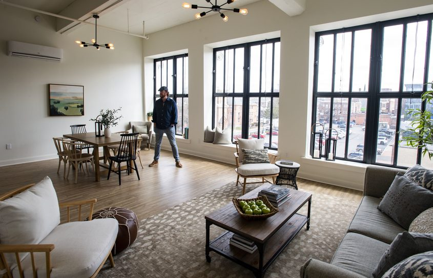 Jeff Buell stands in the living room of a fourth-floor apartment at 132 BroadwayonThursday.