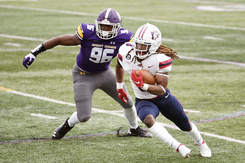 UAlbany defensive end Jared Verse (96) chases down Stony Brook running back Seba Nekhet during a Saturday, March 27, game at Tom & Mary Casey Stadium in Albany. (Photo courtesy Kathleen Helman/UAlbany Athletics)