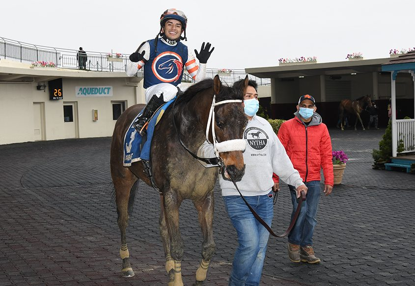 Jockey Eric Cancel holds up six fingers after My Boy Tate won the $100,000 Haynesfield at Aqueduct on Sunday. Cancel rode a total of six winners on the day, tying a NYRA circuit record for a single card. (CHELSEA DURAND/NYRA PHOTO)