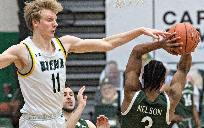 Siena's Bennett Kwiecinski, left, is leaving the program.