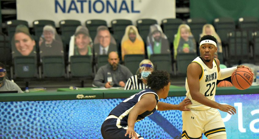 Siena's Jalen Pickett at the Alumni Recreation Centerin January in front empty stands with cardboard cutouts.