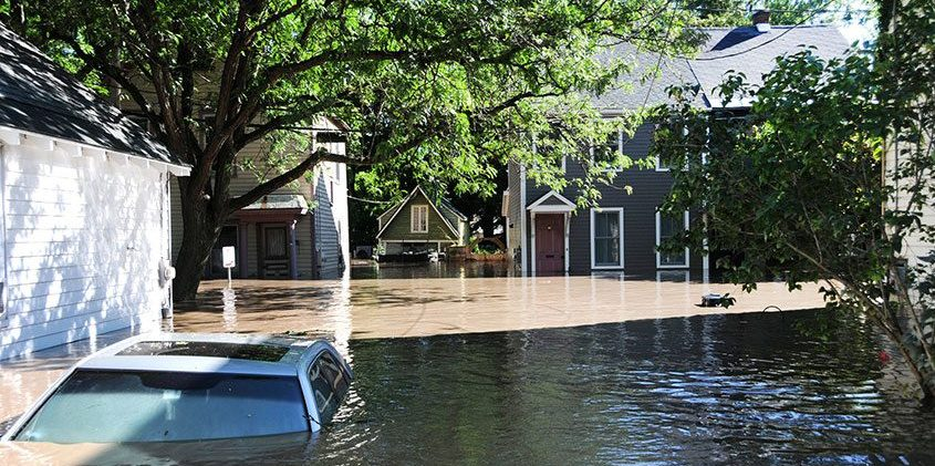 A car is submerged in flood waters on North Street in Schenectady's Stockade, Aug. 29, 2011.