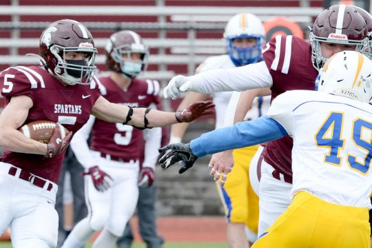 Michael Puglisi of Burnt Hills-Ballston Lake runs with the football during Friday's Class A game against Queensbury at Burnt Hills-Ballston Lake's Centennial Field.