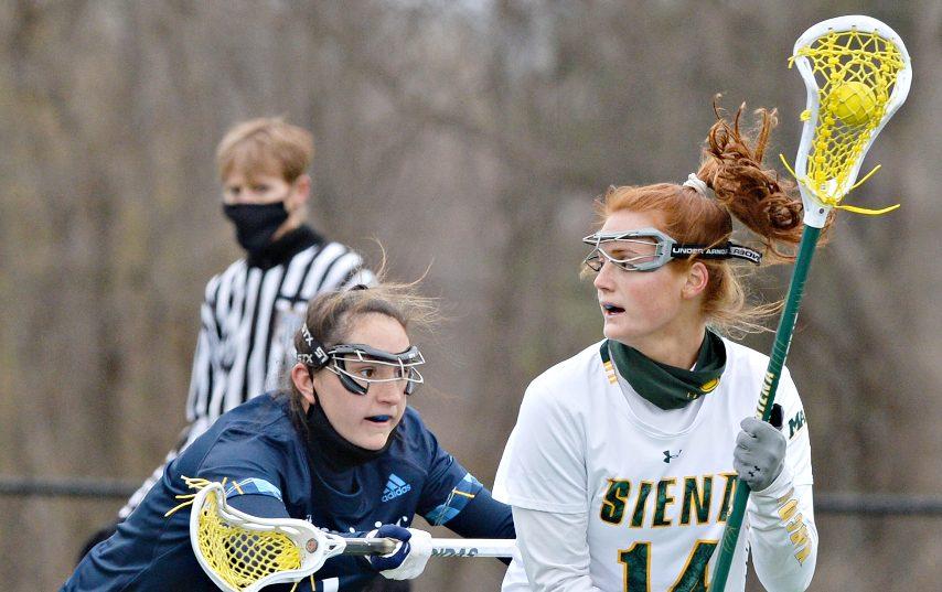 Siena's Kaitlyn Dowsett, right, scored 7 goals in Siena's win Friday in Loudonville.