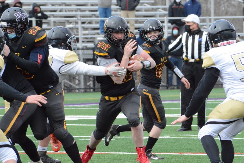 Canajoharie/Fort Plain's Max Prime (22) carries the ball against Helderberg Valley during a football game on Friday, April 2 at Lynch Literacy Academy in Amsterdam.