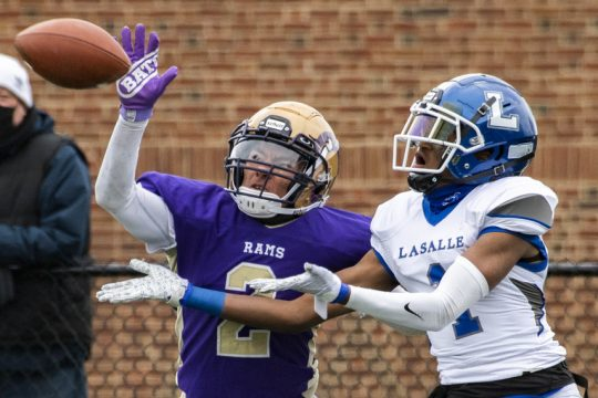 Amsterdam's Josiah Newborn breaks up a pass intended for La Salle's Nassir Youngon Friday, April 2 at Lynch Literacy Academy in Amsterdam.