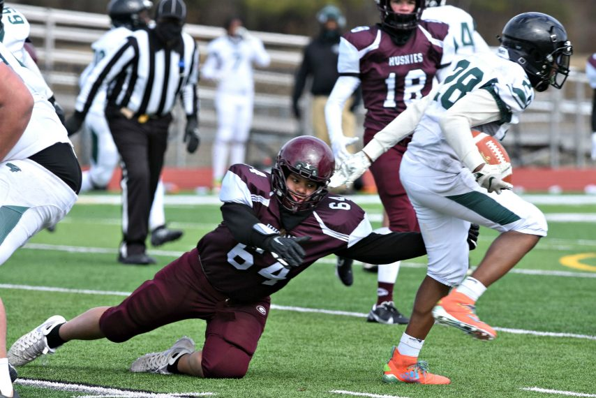 Gloversville's Andrew Brae Jr. can't get a handle on Green Tech's Jahzanear Pointer Friday afternoon at Broadablin-Perth High School in Class B football action. April 2, 2021.