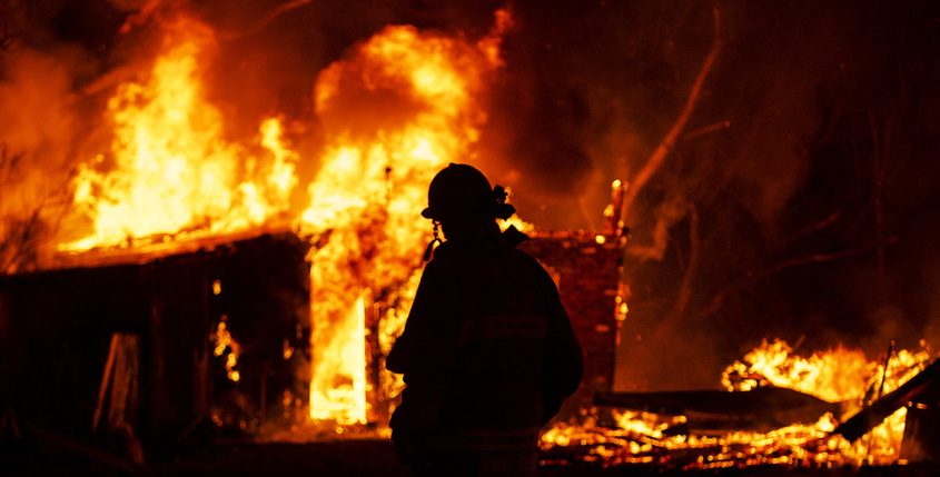 Rotterdam Fire District 2 Chief Andrew Burke surveys the spread of the fire Thursday night