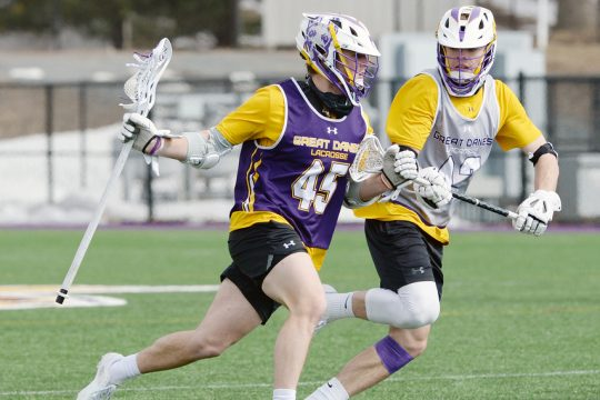 ERICA MILLER/THE DAILY GAZETTE Graydon Hogg (45), shown at practice on March 3, scored six goals in UAlbany's 17-6 win over UMass Lowell on Saturday.