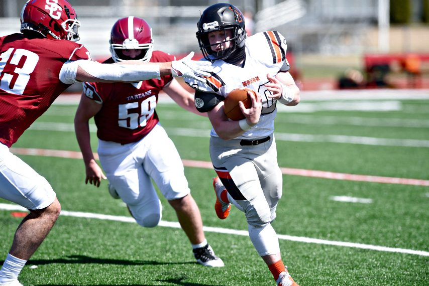 Mohonasen's Jacob Deguire turns the corner as Scotia-Glenville's Antonio Cianfarani (left) reaches out in an attempt to slow him down Saturday afternoon at Scotia. (Stan Hudy)
