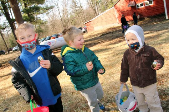From left, Lucas Buck, Jesse Yoder and Everett Lynch celebrate finding golden eggs, which earn them a special prize, during the children's Easter egg hunt at the H.C. Smith Benefit Club in St. Johnsville on Saturday, April 3, 2021.