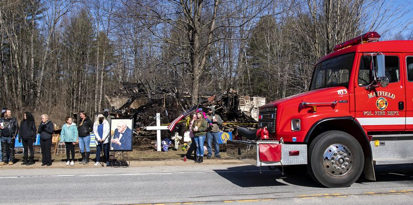 A Mayfield fire truck passes in front of Earl Hare's home Saturday