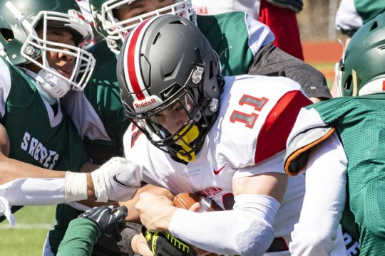 Niskayuna's Dan Quinn is wrapped up by Schalmont's Rodney Parker, left, and Cole Contompasis Saturday, April 3, 2021.