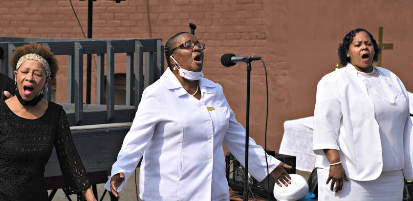 Members of the women's choir sing to celebrate Resurrection Day on Sunday morning during the outdoor services held at Duryee Memorial AME Zion Church in Schenectady.