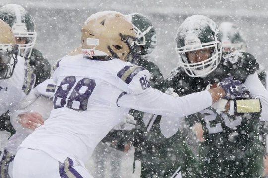 Shenendehowa's Dyvante Terrelonge with the ball against CBA's David Clement during their high school football game in the snow at Shenendehowa High School in Clifton Park on Thursday