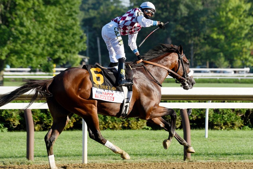 Jockey Manny Franco celebrates after Tiz the Law dominates the Travers at Saratoga on Aug. 8, 2020.