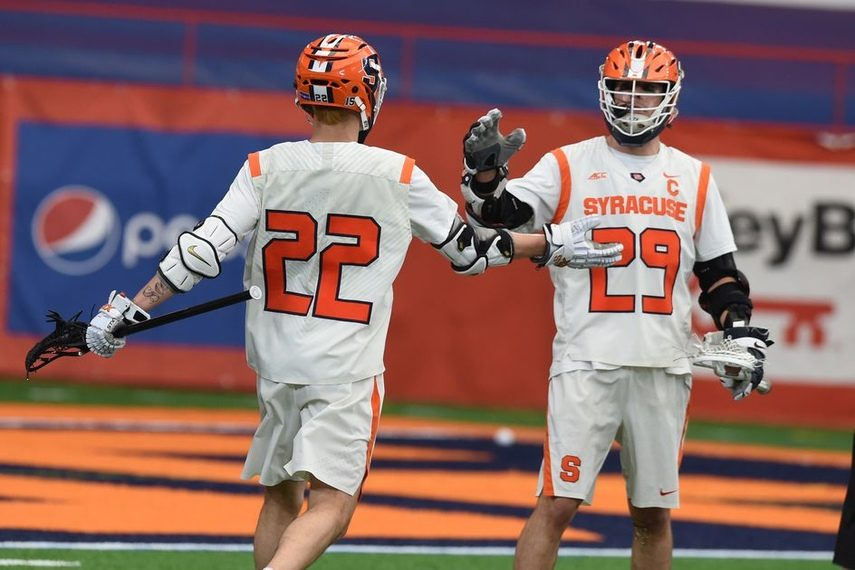 SCOTT SCHILD/SYRACUSE.COMShaker grad Stephen Rehfuss (29) and Chase Scanlan celebrate a Syracuse goal against Notre Dame last Saturday.