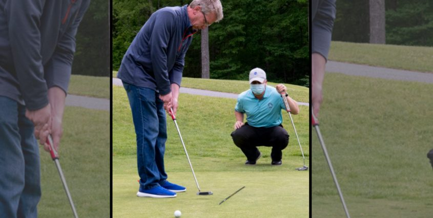 Tony Riggi gets some putting instruction from Schenectady Municipal Golf Course professional Matthew J. Daley on the practice green in June 2020