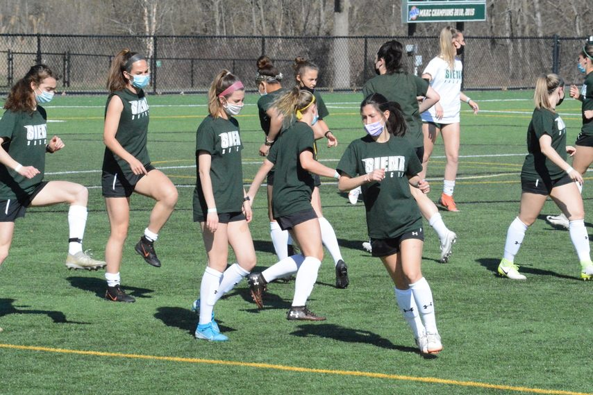 Siena women's soccer players warm up at the start of practice on Wednesday, April 7 at Hickey Field in Loudonville.