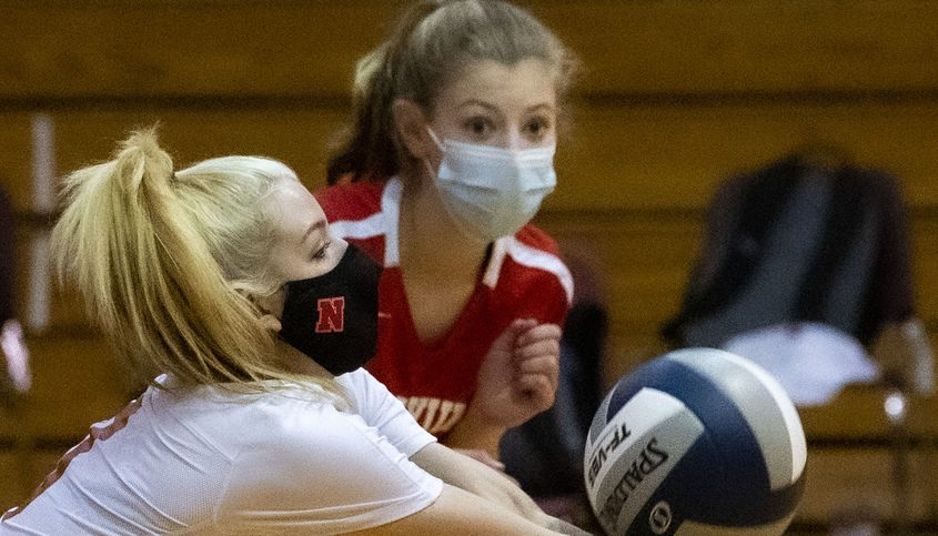 Niskayuna's Cailin Moskow returns a volley against Troy with teammate Laura Mason Wednesday