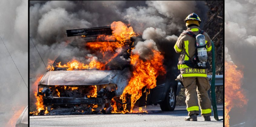 A Pattersonville firefighter waits for water as a minivan burns late Thursday afternoon
