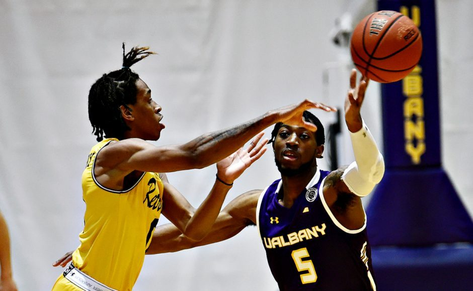 UAlbany's Jamel Horton, right, will stay with the men's basketball program. (Photo courtesy Kathleen Helman/UAlbany Athletics)