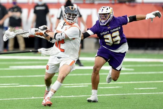 DENNIS NETT/SYRACUSE.COMUAlbany midfielder Ron John (33) chases Syracuse midfielder Jamie Trimboli during their game at the Carrier Dome on Thursday.