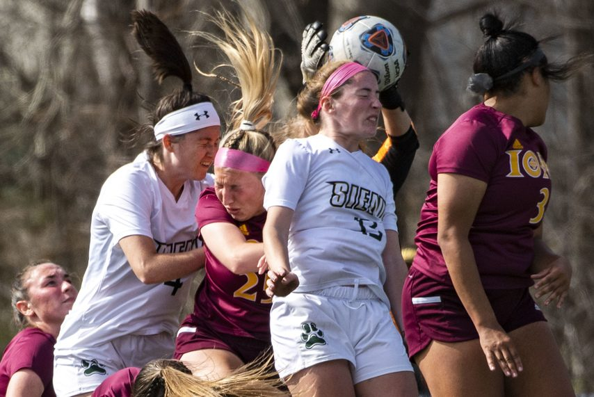 PETER R. BARBER/THE DAILY GAZETTE Siena's Carrie Krohn (13) tries to get her head on a corner kick against Iona on Friday.