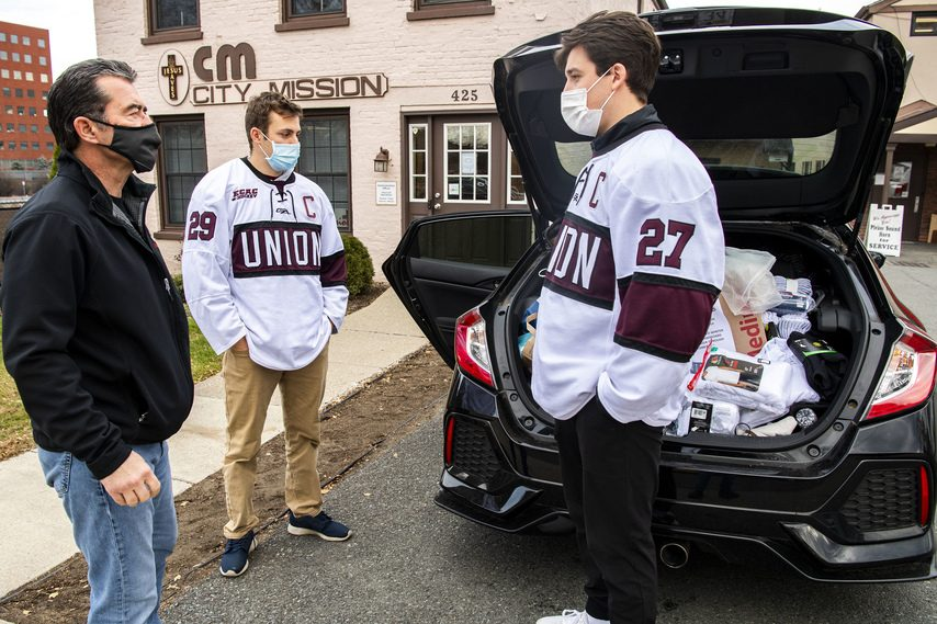 PETER R. BARBER/STAFF PHOTOGRAPHERUnion senior Josh Kosack (27) organized a coat drive for donation to the Schenectady City Mission in November.