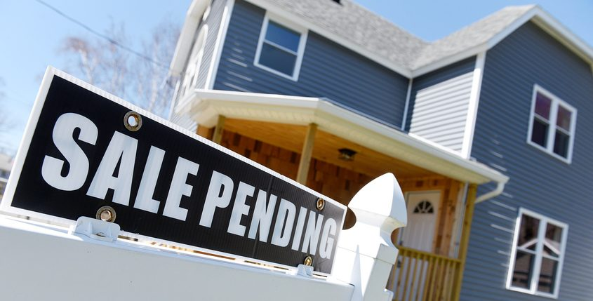 """A home for sale in Amsterdam with a """"sale pending"""" sign attached Friday"""