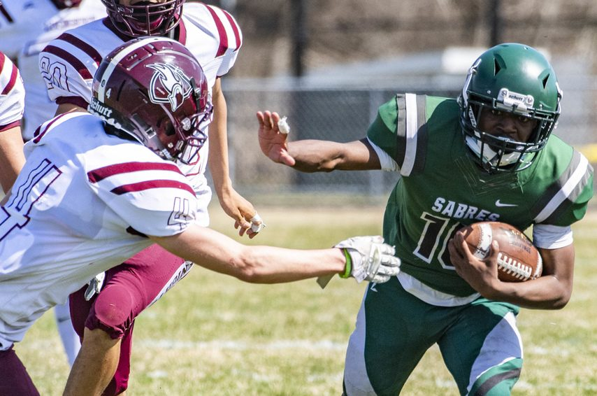 Schalmont's Trent Randle tries to hold offto Lansingburgh defenders during Saturday's game in Rotterdam.