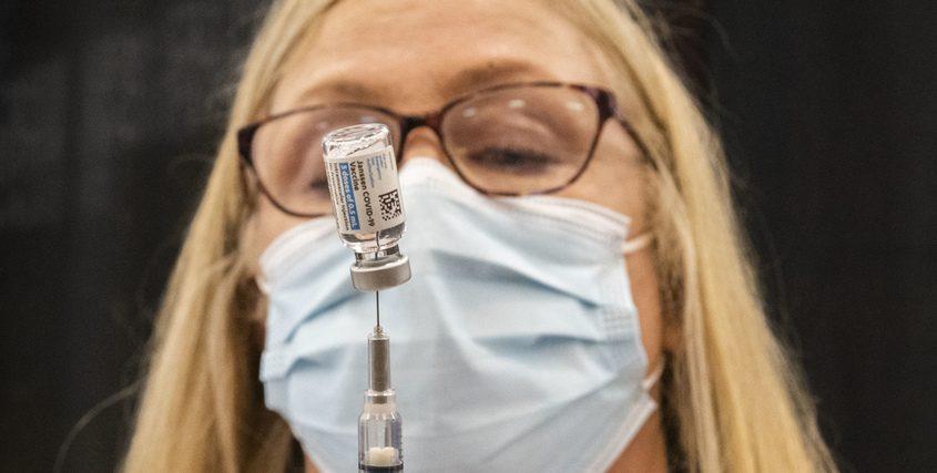 RN Joan Thompson prepares the Johnson & Johnson single dose COVID-19 vaccine shot at the Union College Viniar Center Friday