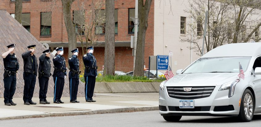Members of the Schenectady Police Department, Sheriff's Department and Fire Department stand in formation outside the Schenectady police station as thehearse carrying the body of retiredcitypolice Sgt. Ray Wemple drives past on Monday.