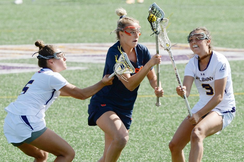 Syracuse's Katelyn Mashewske with the ball against UAlbany's Clancy Rheude and Kyla Zapolski during Tuesday's non-conference women's lacrosse game at John Fallon Field.