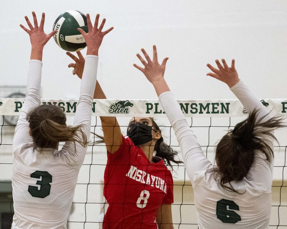 Niskayuna's Cat Schiavi returns a volley between Shenendehowa's Rose Talty, left, and Abby Case during Tuesday's Suburban Council girls' volleyball match.