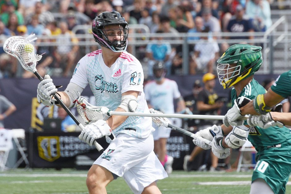 The Chrome's Max Tuttle with the ball against the Redwoods' Patrick Harbeson during their Premier Lacrosse League game at UAlbany's Tom & Casey Stadium on Aug. 25, 2019.