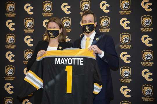 Former Union College hockey goalie Kris Mayotte holds a Colorado College jersey with athletic director Lesley Irvine. Mayotte was introduced as the Tigers' new had coach on Monday.