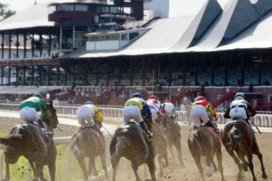 Horses make the final turn in front of an empty grandstandat Saratoga Race Course on Sept. 7, the final day of the 2020 racing meet at the historic track.