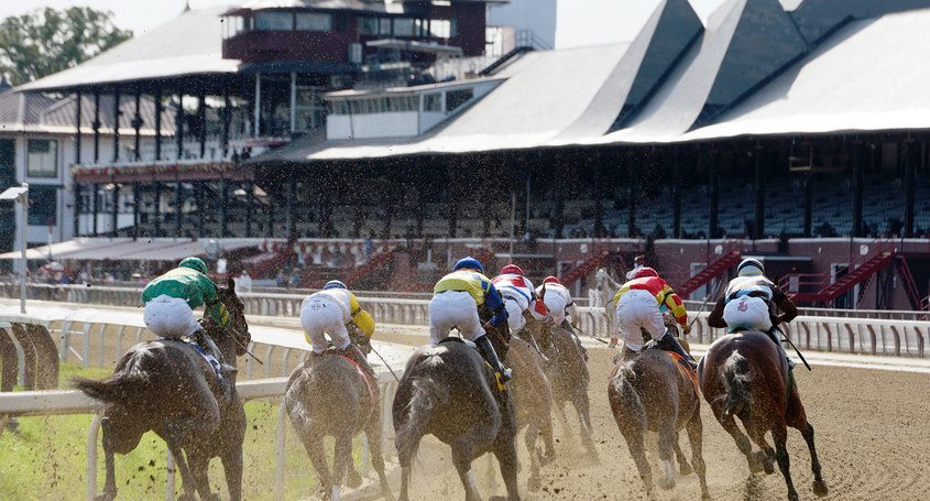 Horses make the final turn in front of an empty grandstand at Saratoga Race Course on Sept. 7, the final day of the 2020 racing meet at the historic track.