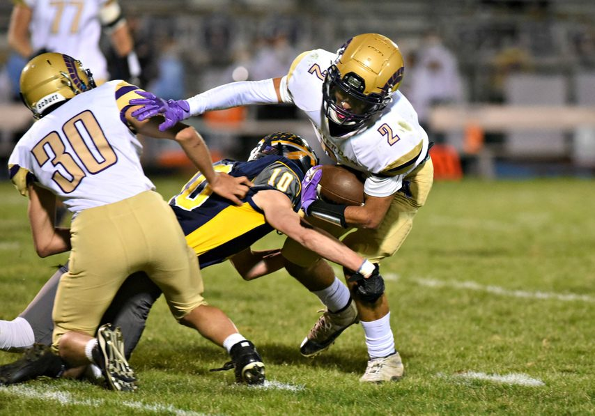 Amsterdam's Josiah Newborn (2) looks to break away from an Averill Park defender during during Friday night's game at Averill Park High School.