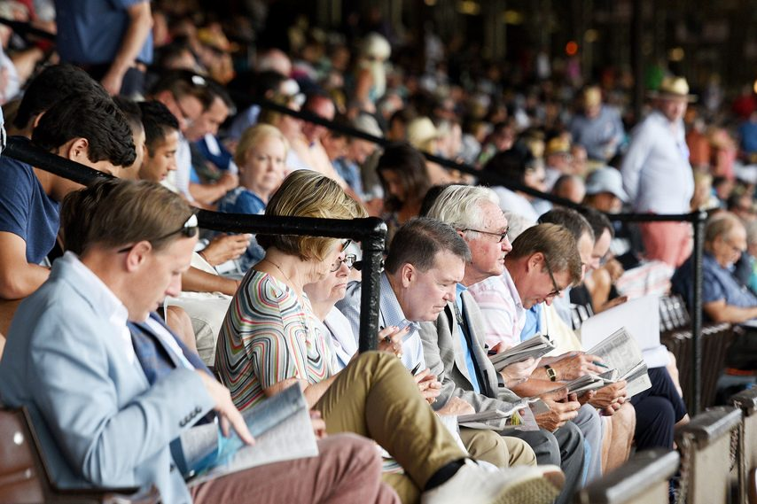 Fans pack the Saratoga Race Course grandstand seats on Travers Day in 2019.