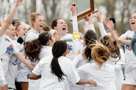 Siena women's soccer team celebrate their MAAC championship game win over Monmouth on Friday at Hickey Field in Loudonville.