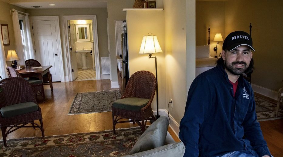 Matthew DiCarlo sits in one of the suites at the Springwater Bed-and-Breakfast on George Street in Saratoga Springs on Saturday
