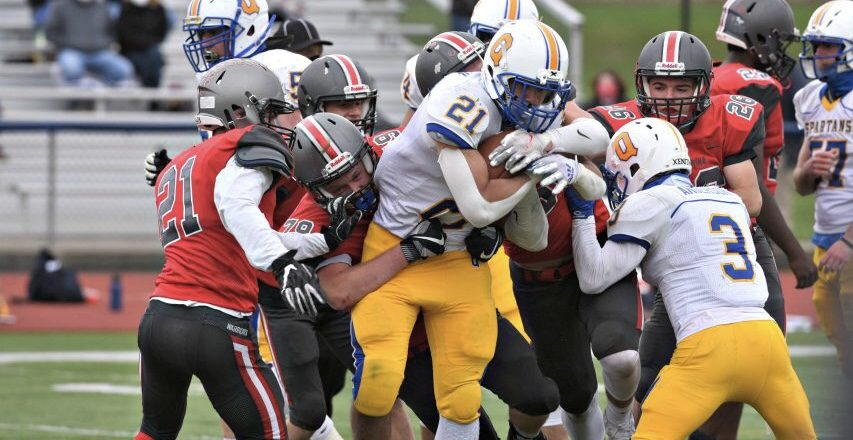 The Silver Warriors defense had their hands full against Queensbury rusher Jason Rodriguez (21) Saturday afternoon
