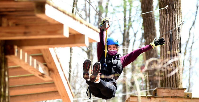 Carissa Shanahan of Cohoes enjoys her ride on a short zip-line on the Spirit Course Sunday afternoon at Mountain Ridge Adventure, 300 Weatherwax Road, in Glenville. She joined her Firestorm FC as part of their team outing.
