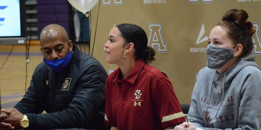 Amsterdam track and field sprinter Charli Beekman, center, accompanied by her parents Charles, left, and Tracy, right, speaks Monday at Amsterdam High School after signing her National Letter of Intent to compete at Boston College.
