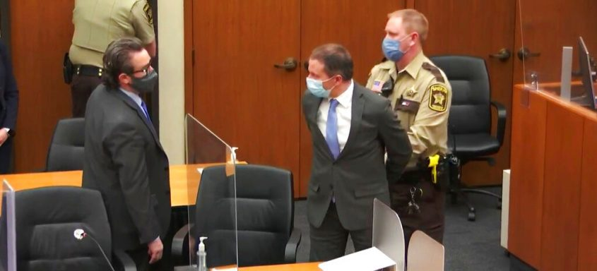 Minneapolis police Officer Derek Chauvin, center, is taken into custody after the verdict was read Tuesday